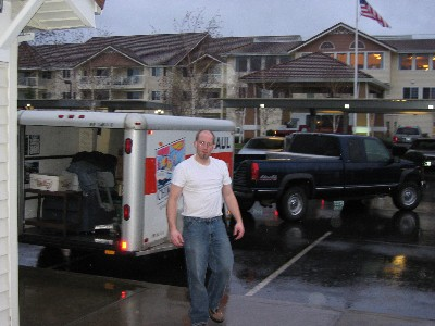 Real men wear…uh, real men load vehicles in therain…